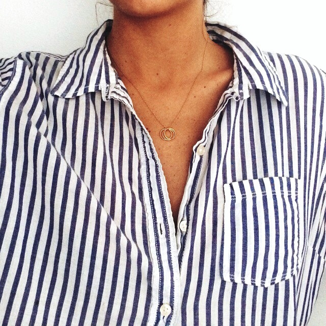 Le-Fashion-Blog-Jewelry-Crush-Dainty-Delicate-Necklaces-Dogeared-Karma-Charm-Necklace-Striped-Shirt-Via-Colby-Milano-Moeh-Fashion