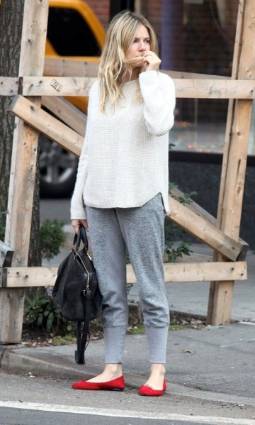 Le-Fashion-Blog-Sienna-Miller-Wavy-Hair-White-Ribbed-Sweater-Grey-Sweat-Pants-Black-Sofia-Coppola-Suede-Bag-Red-Flats-Celebrity-Style